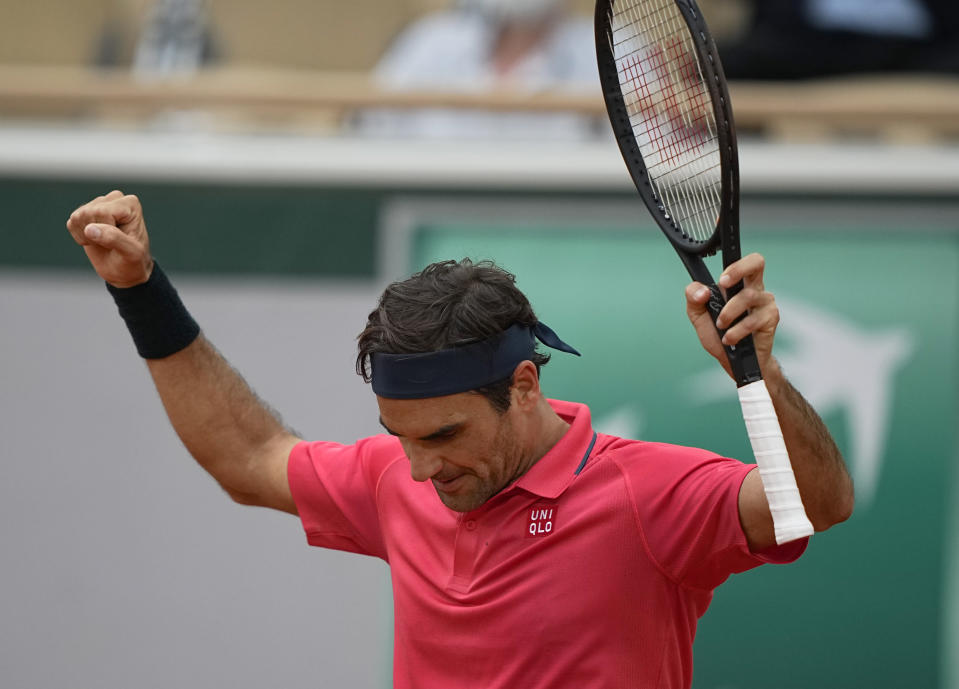 Switzerland's Roger Federer celebrates after defeating Croatia's Marin Cilic in their second round match on day 5, of the French Open tennis tournament at Roland Garros in Paris, France, Thursday, June 3, 2021. (AP Photo/Michel Euler)