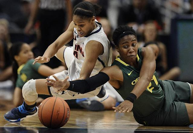 Connecticut's Moriah Jefferson, left, and Oregon's Chrishae Rowe, right, chase a loose ball during the first half of an NCAA college basketball game, Wednesday, Nov. 20, 2013, in Hartford, Conn. (AP Photo/Jessica Hill)