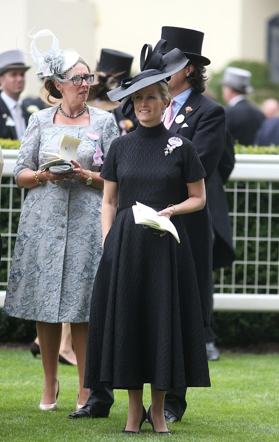 <p>In 2014, the familiar royal face opted for a full black look instead of the usual colour.<br><i>[Photo: PA]</i> </p>