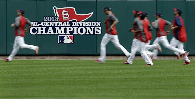 Members of the St. Louis Cardinals run sprints in the outfield during baseball practice Tuesday, Oct. 1, 2013, in St. Louis. The Cardinals are set to host Game 1 of the NL Division Series on Thursday against the winner of the NL wild-card game between the Cincinnati Reds and the Pittsburgh Pirates. (AP Photo/Jeff Roberson)