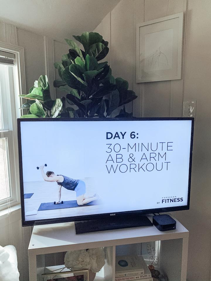 """<h2>Day 4: Yoga and Restorative Meditation With Koya Webb</h2> <p>I have been soooo looking forward to this workout. I haven't <a href=""""https://www.popsugar.com/fitness/best-yoga-workouts-on-youtube-46872806"""" class=""""ga-track"""" data-ga-category=""""Related"""" data-ga-label=""""https://www.popsugar.com/fitness/best-yoga-workouts-on-youtube-46872806"""" data-ga-action=""""In-Line Links"""">done yoga</a> in months and have been seriously longing for a class. This was such a wonderful addition to the routine of butt-kicking strength and cardio from the past few days.</p> <p>Koya's energy was exactly what I needed this week. Her voice is like the auditory equivalent of CBD oil and bedtime stories. Her emphasis on recovery being as important as exercise itself really spoke to my soul (can you tell this is an important subject to me?), and the stretching made me realize just how sore I was from the past three days, so it was perfectly timed.</p> <h2>Day 5: Dance Cardio With Amanda Kloots</h2> <p>I've always wanted to take one of Amanda's upbeat dance classes, so I was thrilled to see her workout on this program! This was the fastest 27 minutes of my life - it seriously flew by. And while you're only really dancing for about 20 minutes (with three minutes each for warmup and cooldown), you break such a sweat. This was another one of those, """"Is my heater on?"""" workouts.</p> <h2>Day 6: Ab and Arm Workout With Jake Dupree</h2> <p>The last workout of the week was back with Jake, focusing on arms and abs. It also happened to be the only one that required equipment! I quickly realized that my free weights are at my mom's house (cool, cool, cool), so I used wine bottles instead. It seemed on brand.</p> <p>I loved ending the week with a little more ab work. This was a good combination of strength and cardio, and to be honest, I kind of felt like I was at Barry's Bootcamp, minus the red lights and chaos. And while I'm always up for a Barry's workout, I was happy to save the fee and be spared from the d"""