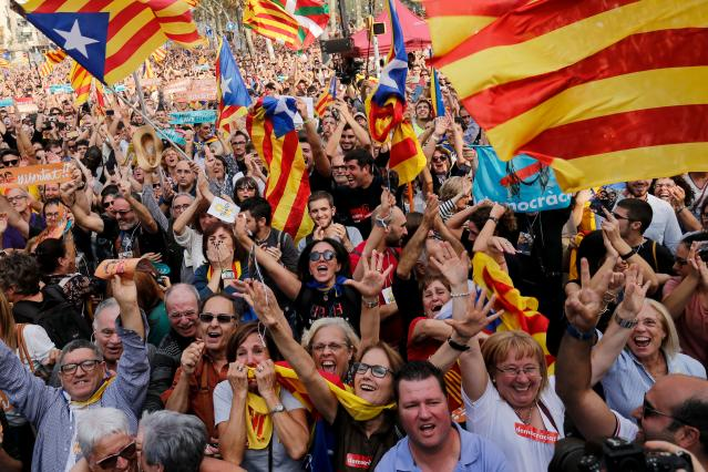 People celebrate after Catalonia's Parliament voted to declare independence from Spain on Oct. 27. (Photo: Pau Barrena/AFP/Getty Images)