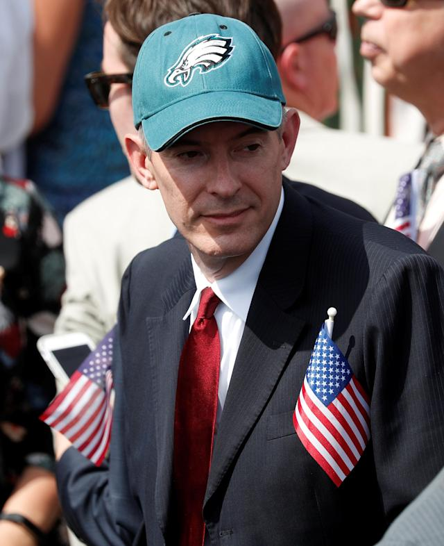 "A guest wears a Philadelphia Eagles hat and two U.S. flags at U.S. President Donald Trump's ""celebration of America"" event on the South Lawn of the White House in Washington, U.S., June 5, 2018. The event was arranged after Trump canceled the planned visit of the Super Bowl champion Philadelphia Eagles to the White House. REUTERS/Kevin Lamarque"
