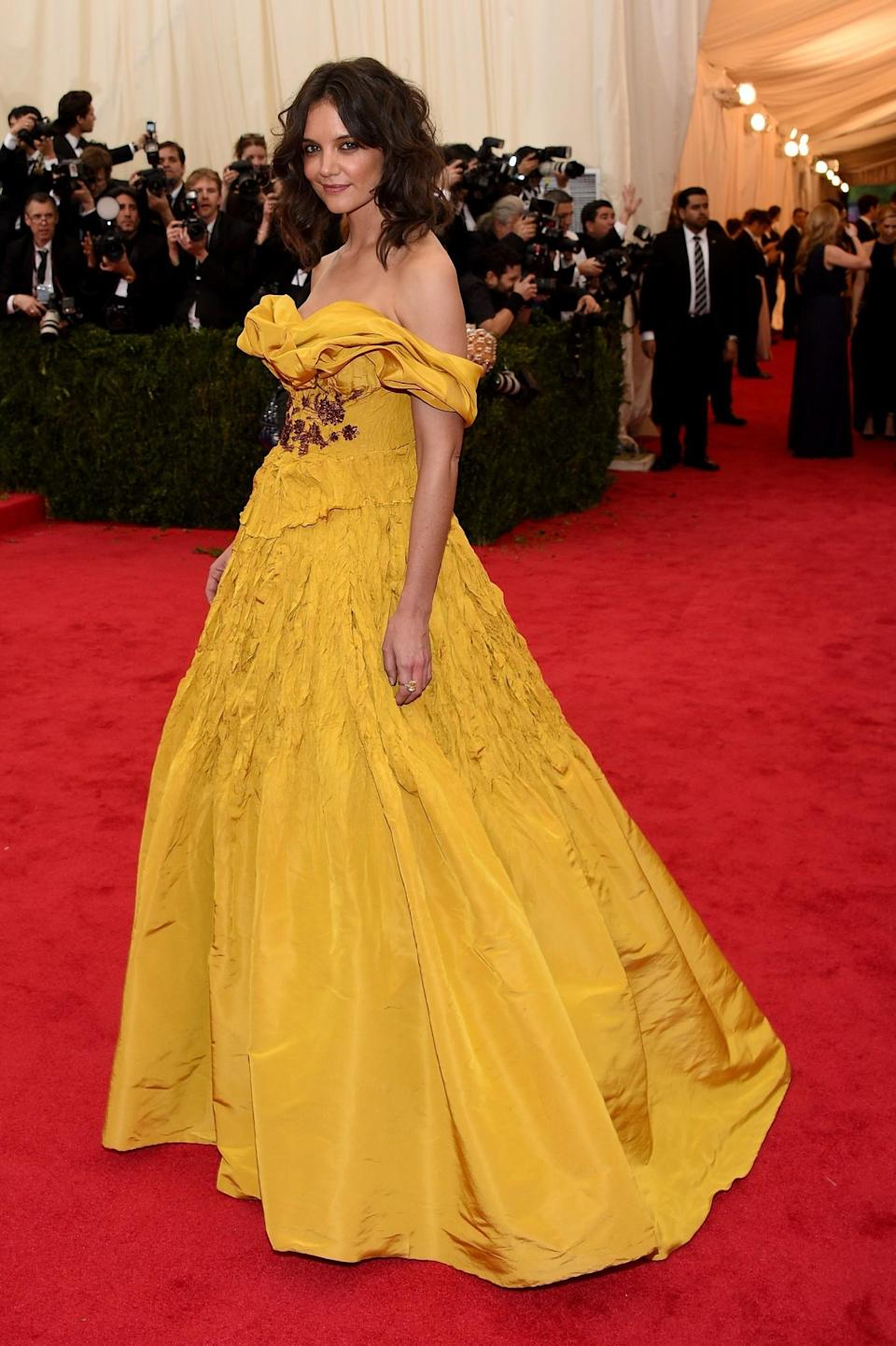 <p>Katie Holmes was ahead of the trend in 2014 when she wore an off-the-shoulder Belle inspired frock to the Met Gala. [Photo: Getty] </p>