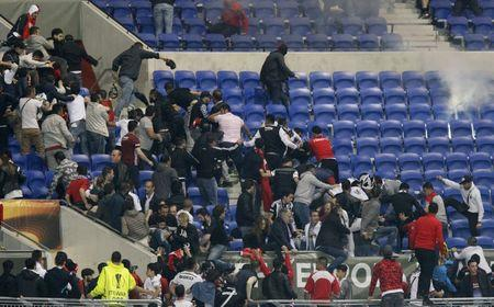 Football Soccer - Olympique Lyonnais v Besiktas - UEFA Europa League Quarter Final First Leg - Parc Olympique Lyonnais - 13/4/17 Besiktas and Lyon fans clash in the stands Reuters / Emmanuel Foudrot Livepic
