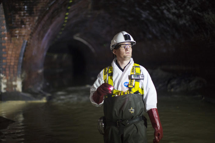Image: An operations manager inside a sewer in London. (Jack Taylor / Getty Images file)