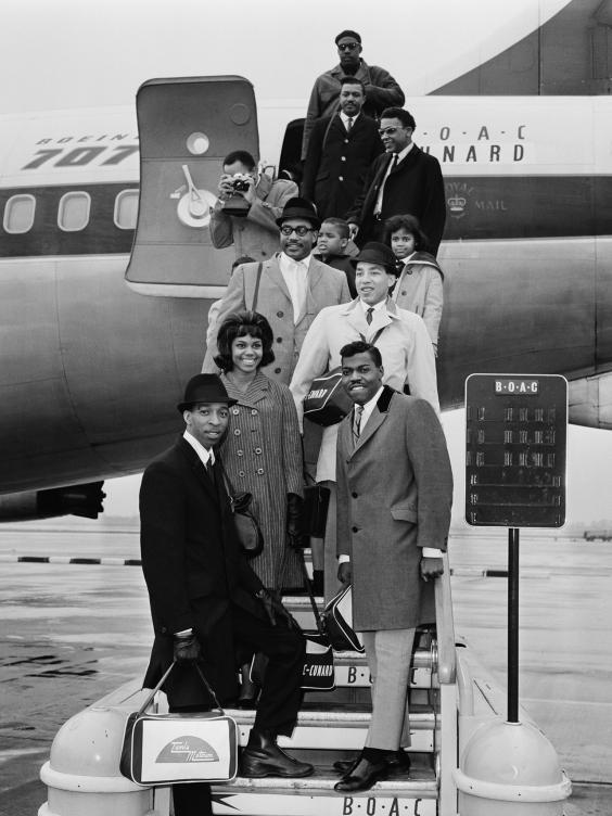 The Miracles at London (now Heathrow) airport in March 1965. Clockwise, from bottom, left: Ronnie White, Claudette Robinson, Bobby Rogers, Smokey Robinson and Pete Moore (Getty)