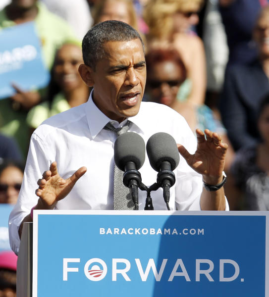 President Barack Obama speaks to supporters as he lays out his plan to move the country forward, Tuesday, Oct. 23, 2012, during a campaign stop in Delray Beach, Fla. (AP Photo/Alan Diaz)
