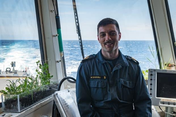 Petty Officer 2nd Class John Reid McDougall started a garden in the flight deck control room of HMCS Halifax earlier this spring. (Sailor 1st Class Bryan Underwood - image credit)