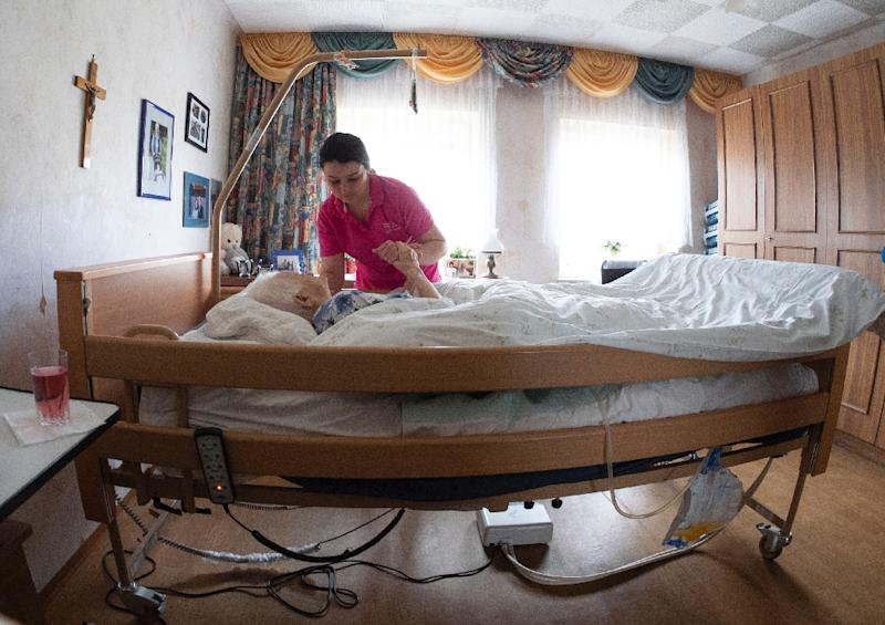 Slovakian care giver Alena Konecna makes her living caring for an 89-year-old in Austria thanks to the free movement of labour in the European Union (AFP Photo/JOE KLAMAR)