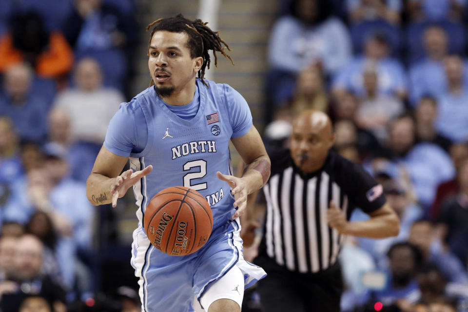 FILE - In this March 11, 2020, file photo, North Carolina guard Cole Anthony (2) dribbles against Syracuse during the first half of an NCAA college basketball game at the Atlantic Coast Conference tournament in Greensboro, N.C. Anthony is considered a first-round prospect and one of the top point guards in the NBA draft on Nov. 18. (AP Photo/Ben McKeown, File)