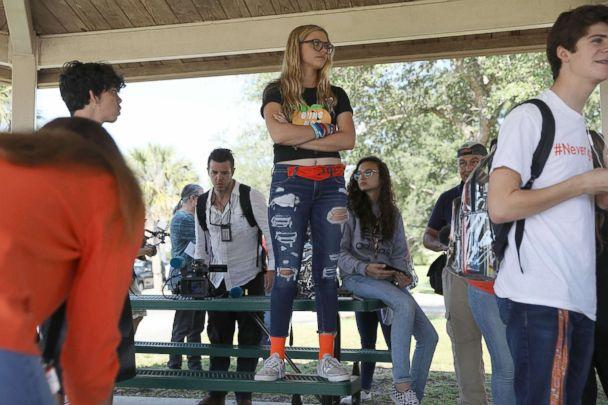 PHOTO: Delany Tarr (C), a senior, gathers together with some of her fellow students from Marjory Stoneman Douglas High School, where 17 classmates and teachers were killed during a mass shooting, April 20, 2018, in Parkland, Fla. (Joe Raedle/Getty Images)