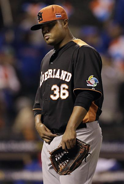The Netherlands' Diegomar Markwell (36) walks off the mound after being relieved during the fifth inning of a semifinal game of the World Baseball Classic against the Dominican Republic in San Francisco, Monday, March 18, 2013. (AP Photo/Eric Risberg)