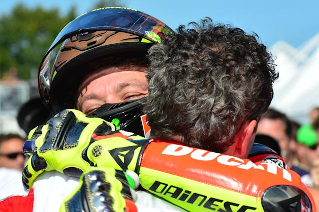 Italian rider Valentino Rossi (L) of the Ducati team celebrates with a teammate after the San Marino MotoGP Grand Prix on September 16 , 2012 at the Misano world circuit in Missano Adriatico. Spanish rider Jorge Lorenzo won ahead of Italians Valentino Rossi and Alvaro Bautista. AFP PHOTO / GIUSEPPE CACACEGIUSEPPE CACACE/AFP/GettyImages