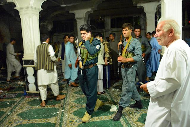 <p>Afghan security personel inspect the site of a suicide bomb attack at a Shiite mosque in Herat on August 1, 2017. (Photo: Hoshang Hashimi/AFP/Getty Images) </p>