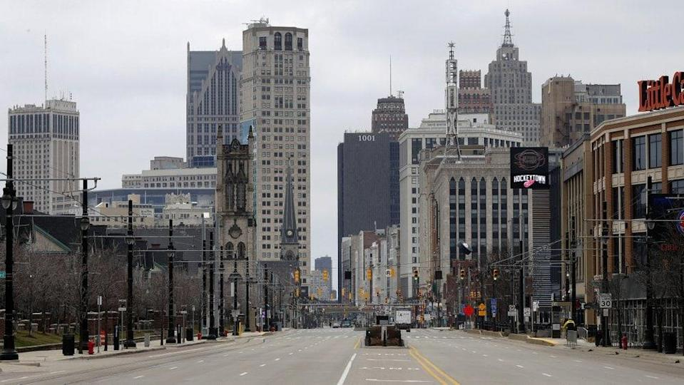 In this March 24, 2020 file photo, Woodward Avenue is shown nearly empty in Detroit. Before the coronavirus showed up, downtown Detroit was returning to its roots as a vibrant city center, motoring away from its past as the model of urban ruin. (AP Photo/Paul Sancya)