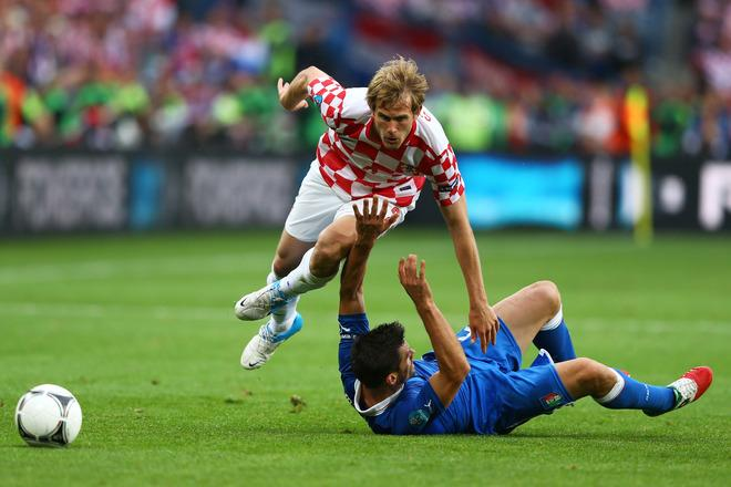 POZNAN, POLAND - JUNE 14:  Cristian Maggio of Italy and Ivan Strinic of Croatia clash during the UEFA EURO 2012 group C match between Italy and Croatia at The Municipal Stadium on June 14, 2012 in Poznan, Poland.  (Photo by Clive Mason/Getty Images)  *** BESTPIX ***