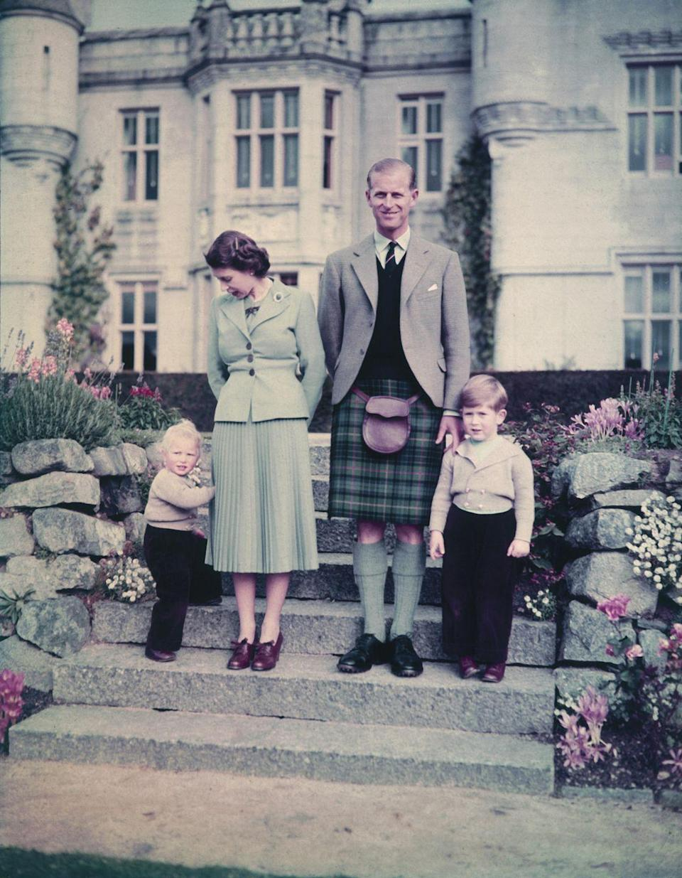 """<p>Queen Elizabeth and Prince Philip with their two young children, Princess Anne and Prince Charles, outside <a href=""""https://www.goodhousekeeping.com/uk/news/a578858/balmoral-everything-you-need-to-know-about-the-queens-scottish-retreat/"""" rel=""""nofollow noopener"""" target=""""_blank"""" data-ylk=""""slk:Balmoral Castle"""" class=""""link rapid-noclick-resp"""">Balmoral Castle</a> in 1952.</p>"""
