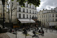 Customers sit at a cafe terrace in the Montmartre district of Paris, Wednesday, May, 19, 2021. Cafe and restaurant terraces reopened Wednesday after a six-month coronavirus shutdown deprived residents of the essence of French life — sipping coffee and wine with friends. (AP Photo/Rafael Yaghobzadeh)