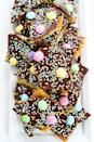 "<p>For a fun Easter treat, make this saltine toffee that's topped with brightly colored candies and sprinkles.</p><p><strong>Get the recipe at <a href=""https://www.twopeasandtheirpod.com/easter-saltine-toffee/"" rel=""nofollow noopener"" target=""_blank"" data-ylk=""slk:Two Peas and Their Pod"" class=""link rapid-noclick-resp"">Two Peas and Their Pod</a>.</strong></p><p><strong><a class=""link rapid-noclick-resp"" href=""https://go.redirectingat.com?id=74968X1596630&url=https%3A%2F%2Fwww.walmart.com%2Fsearch%2F%3Fquery%3Dbaking%2Bmats&sref=https%3A%2F%2Fwww.thepioneerwoman.com%2Ffood-cooking%2Fmeals-menus%2Fg35408493%2Feaster-desserts%2F"" rel=""nofollow noopener"" target=""_blank"" data-ylk=""slk:SHOP BAKING MATS"">SHOP BAKING MATS</a><br></strong></p>"