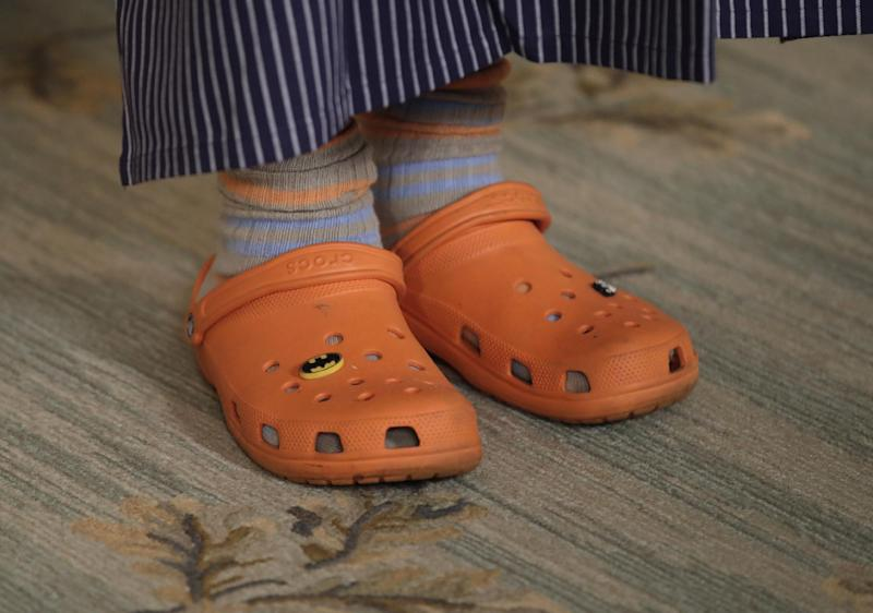 American chef Mario Batali wears his signature orange Crocs during a preview in advance of the State Dinner in honor of the Official Visit of Italian Prime Minister Matteo Renzi and his wife Agnese Landini, Monday, Oct. 17, 2016, in the State Dining Room of the White House in White House. (AP Photo/Carolyn Kaster)