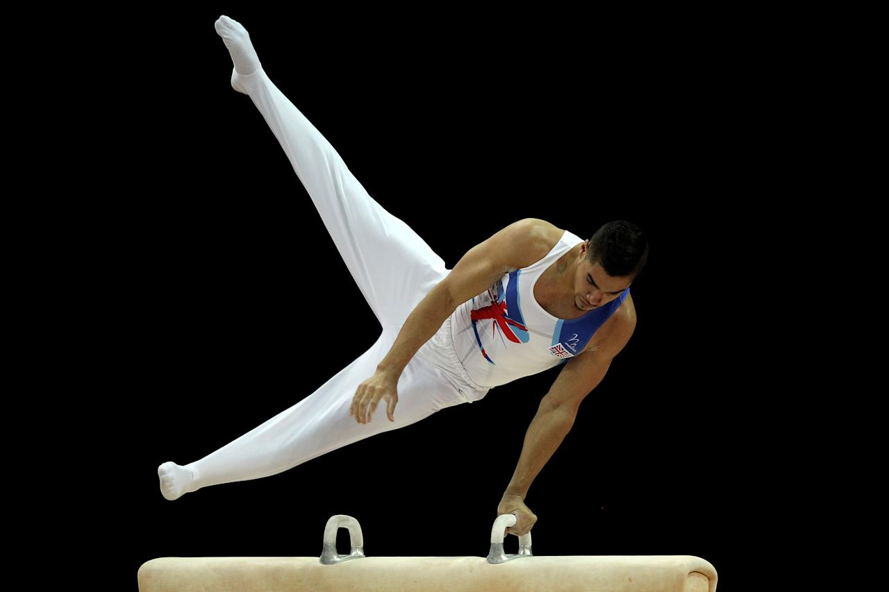 LONDON, ENGLAND - JANUARY 10:  Louis Smith of Great Britain in action on the Pommel Horse during day one of the Men's Gymnastics Olympic Qualification round at North Greenwich Arena on January 10, 2012 in London, England.  (Photo by Ian Walton/Getty Images)