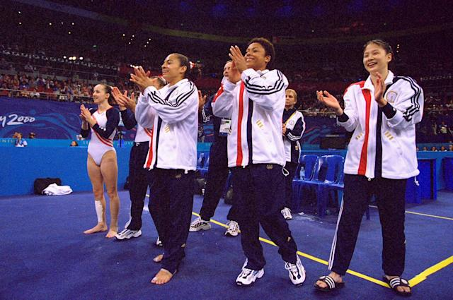 19 Sep 2000: Tasha Schwikert-Warren (left), Dominique Dawes (centre) and Amy Chow (right) of the USA celebrate their fourth place in the Womens Team Gymnastics Final on Day Four of the Sydney 2000 Olympic Games in Sydney, Australia. Mandatory Credit:Billy Stickland/ALLSPORT