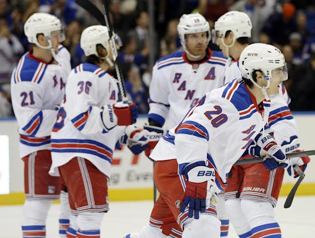 New York Rangers' Chris Kreider (20) skates toward his bench after scoring a goal during the first period of an NHL hockey game against the New York Islanders Tuesday, Oct. 29, 2013, in Uniondale, N.Y. (AP Photo/Frank Franklin II)