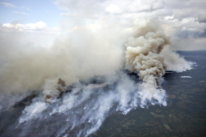 In this aerial photo, an area of the Pagami Creek wildfire shows active burning and creates a large smoke plume on Tuesday Sept. 13, 2011 in the Boundary Waters Canoe Area Wilderness in Northeastern Minnesota. The haze from the fire was heavy enough that some people reported burning eyes and difficulty breathing in the Chicago area, 600 miles south of the forest fire, the National Weather Service said. (AP Photo/The Duluth News-Tribune, Clint Austin)