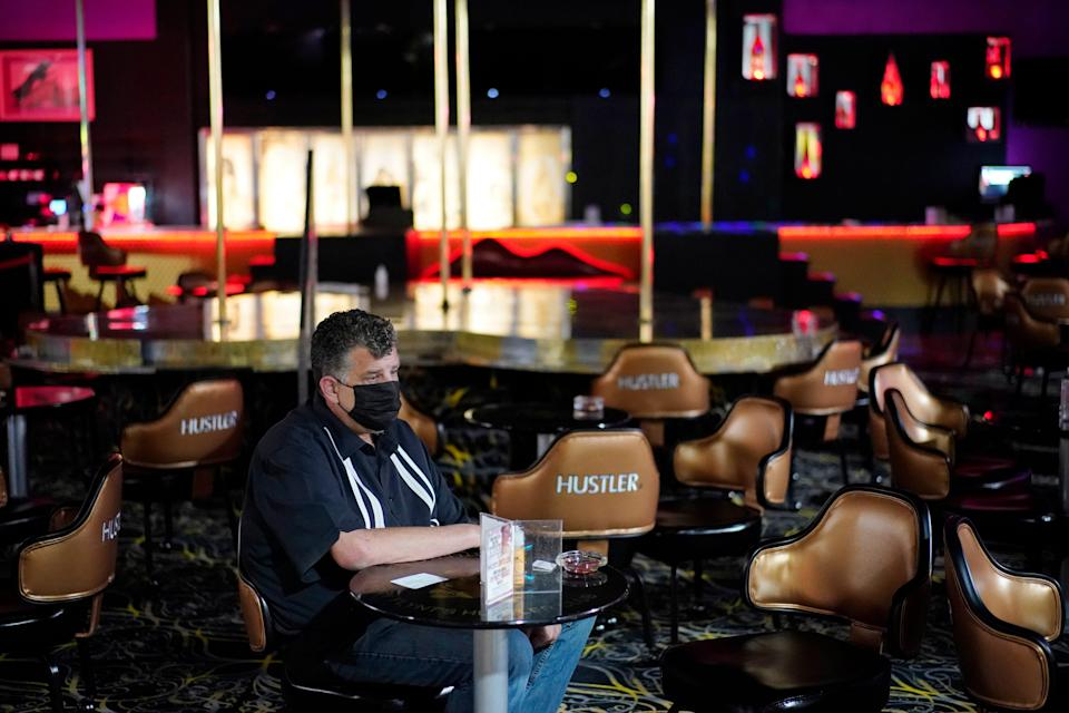 Jeff Cantrell waits at Larry Flint's Hustler Club strip club after getting his second dose of a COVID-19 vaccine Friday in Las Vegas. City officials held a pop-up vaccine clinic at the strip club to encourage more people to get vaccinated.
