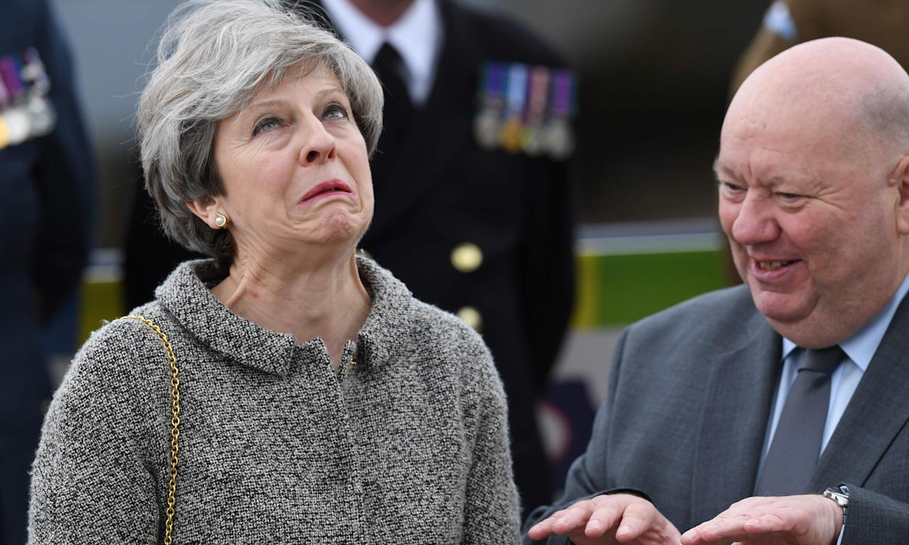 Theresa May and the mayor of Liverpool, Joe Anderson, watch a parade of military personnel to mark Armed Forces Day in Liverpool last week.