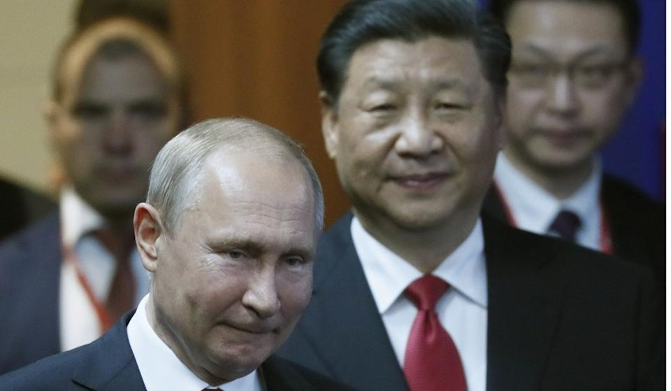 Vladimir Putin Xi Jinping have pledged to increase cooperation in a variety of areas. Photo: EPA
