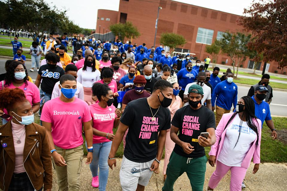 NBA players Dennis Smith Jr. and Chris Paul lead Fayetteville State students over to Smith Recreation Center to vote on Wednesday, Oct. 28, 2020. Paul is traveling the country going to historically black colleges to get people to vote in the upcoming election.