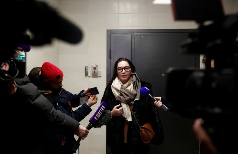 Lawyer Veronika Polyakova speaks to the media as she stands next to an apartment of Russian opposition leader Alexei Navalny in Moscow