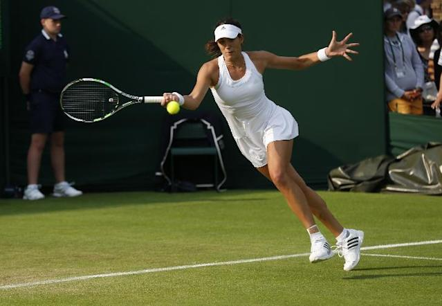 Garbine Muguruza of Spain plays a return to Coco Vandeweghe of the U.S. during their first round match at the All England Lawn Tennis Championships in Wimbledon, London, Monday, June 23, 2014. (AP Photo/Sang Tan)