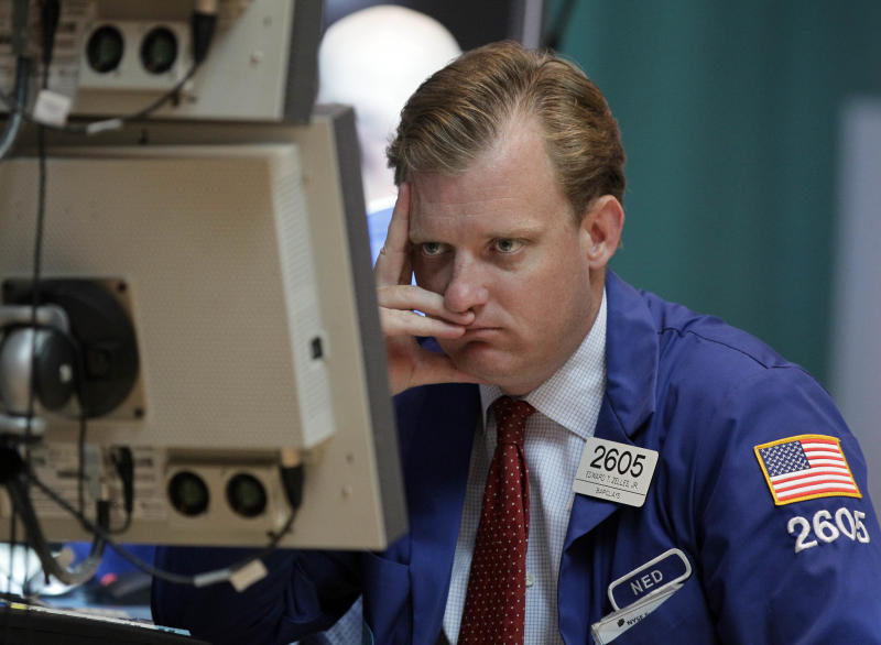 FILE - In this  Thursday, June 28, 2012, file photo, specialist Edward Zelles works on the floor of the New York Stock Exchange. Wall Street appeared headed for gains Friday June 29, 2012. (AP Photo/Richard Drew, File)