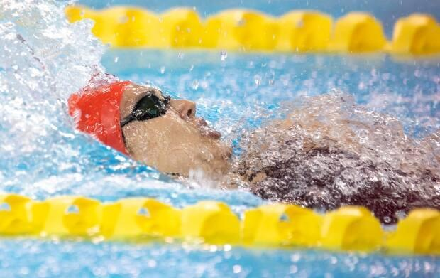 Kylie Masse of LaSalle, Ont., races to a national record at the Canadian Olympic swim trials in the women's 100m backstroke in Toronto on Saturday.  (Frank Gunn/The Canadian Press  - image credit)