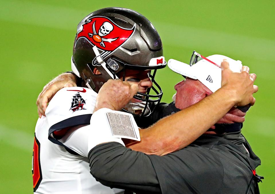 Feb 7, 2021; Tampa, FL, USA;  Tampa Bay Buccaneers quarterback Tom Brady (12) and head coach Bruce Arians celebrate during the fourth quarter in Super Bowl LV against the Kansas City Chiefs at Raymond James Stadium.  Mandatory Credit: Mark J. Rebilas-USA TODAY Sports     TPX IMAGES OF THE DAY