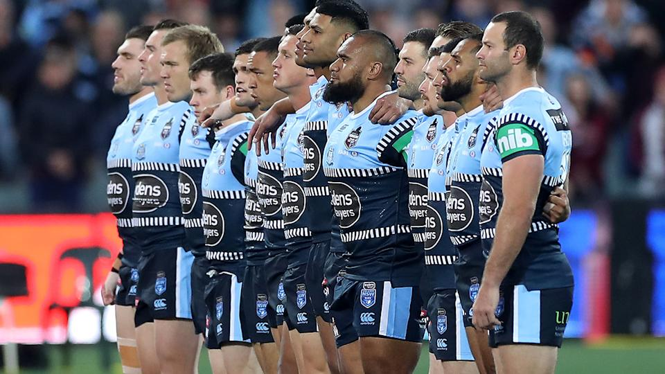 State of Origin players, pictured here during the national anthem.