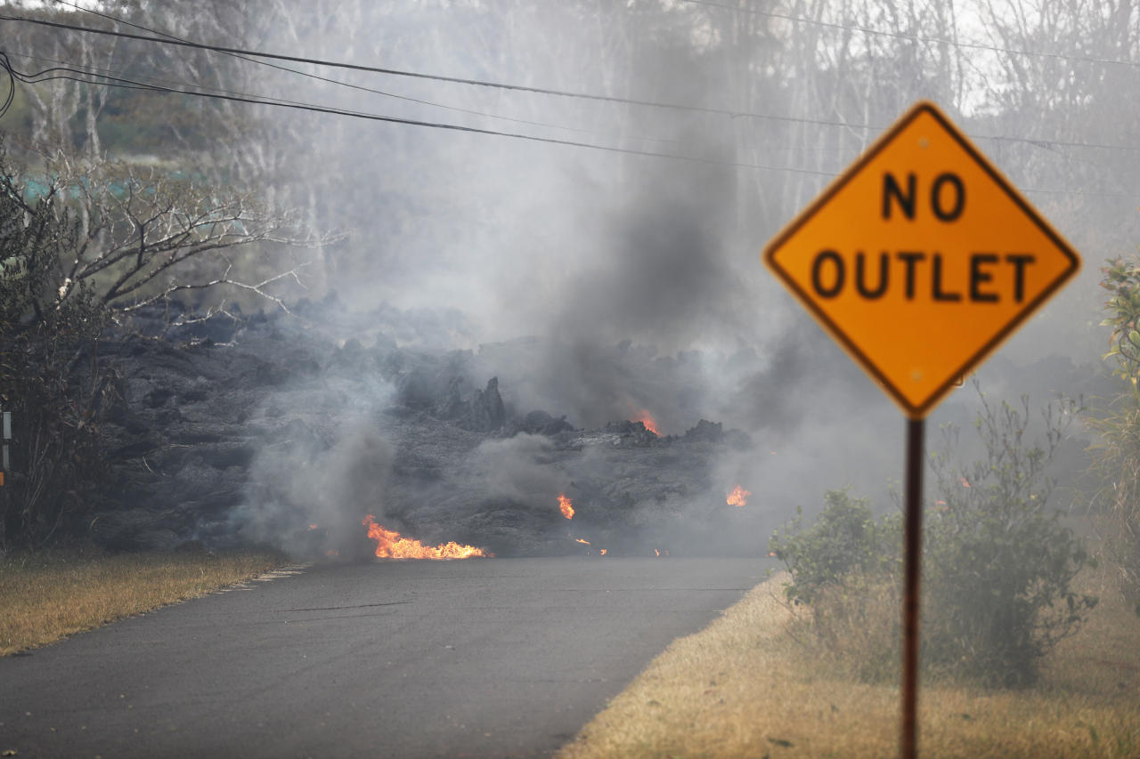 Lava crossed a road and isolated about 40 homes below Hawaii's Kilauea volcano