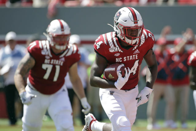 North Carolina State running back Zonovan Knight (24) runs for a touchdown during the first half of an NCAA college football game against East Carolina in Raleigh, N.C., Saturday, Aug. 31, 2019. (AP Photo/Gerry Broome)