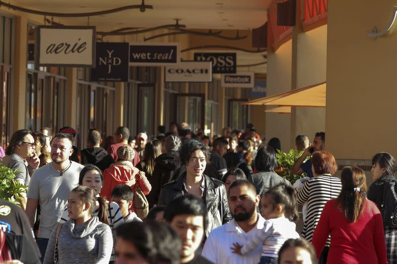 People shop during day after Christmas sales at Citadel Outlets in Los Angeles, California