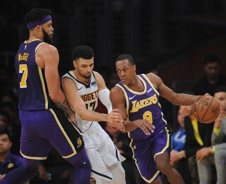 March 6, 2019; Los Angeles, CA, USA; Los Angeles Lakers guard Rajon Rondo (9) moves the ball as center JaVale McGee (7) provides the screen against Denver Nuggets guard Jamal Murray (27) during the first half at Staples Center. Gary A. Vasquez