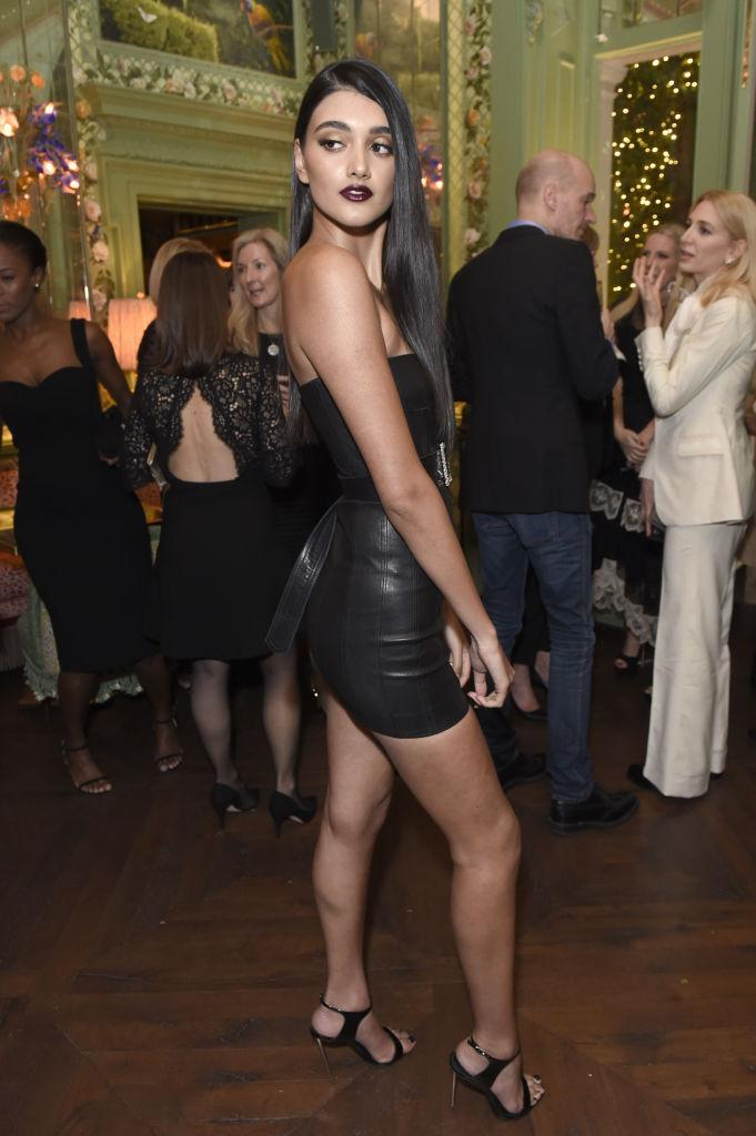 <p>Model Neelam Gill donned a strapless LBD to the fashion event. <em>[Photo: Getty]</em> </p>