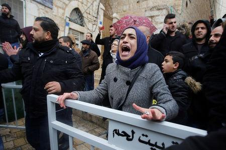 A demonstrator reacts during a protest against the visit of Greek Orthodox Patriarch of Jerusalem Theophilos III, in the West Bank city of Bethlehem January 6, 2018. REUTERS/Mussa Qawasma