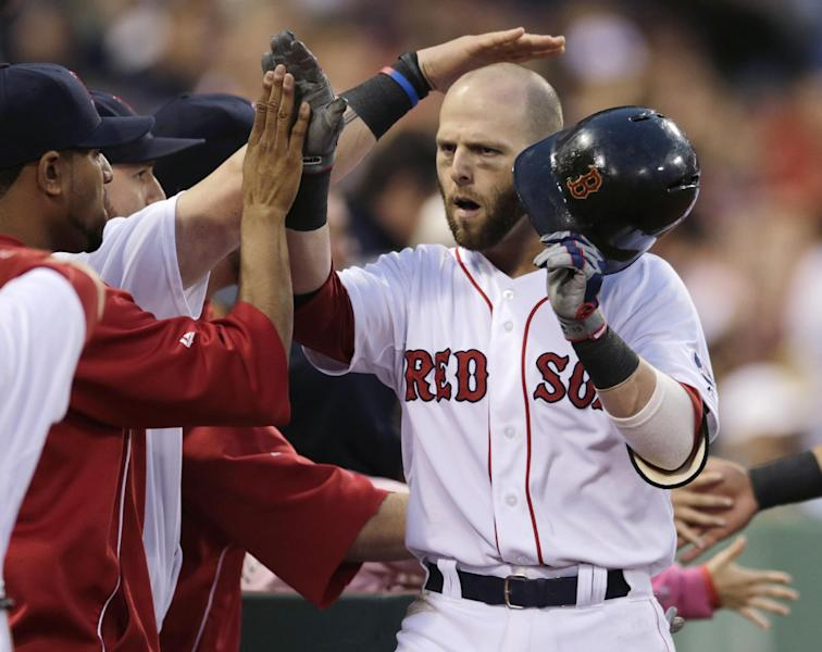 Boston Red Sox's Dustin Pedroia is congratulated by teammates after his two-run home run off Toronto Blue Jays starting pitcher Chien-Ming Wang during the second inning of a baseball game at Fenway Park, Thursday, June 27, 2013, in Boston. (AP Photo/Charles Krupa)