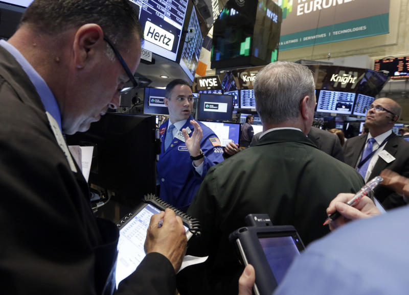 In this  Tuesday, May 28, 2013, photo, Traders gather at the post that handles Hertz on the floor of the New York Stock Exchange.  Stock futures slumped on the final trading day of May, with new data showing that consumers pulled back from their breakneck spending pace in April. (AP Photo/Richard Drew)