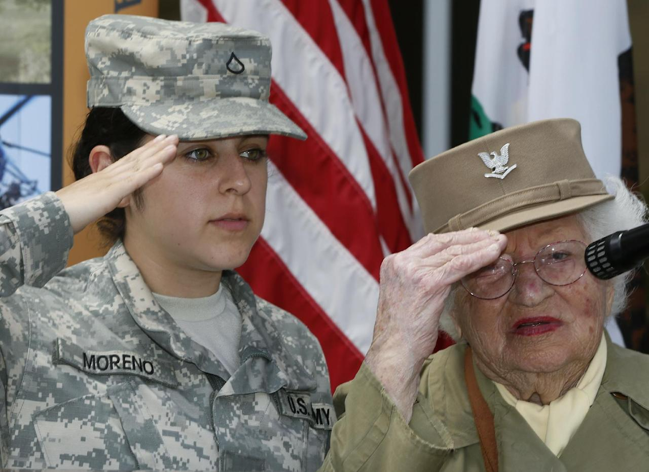 Bea Cohen, 103, the oldest female World War II Army veteran in Calif., right, and Pfc. Ana Moreno, ESC, 24 the youngest soldier present at the ceremony join United States Army veterans celebrating the U.S. Army's 238th birthday, Flag Day at the third anniversary of the West Los Angeles Veterans Home in Los Angeles, Friday, June 14, 2013. (AP Photo/Damian Dovarganes)