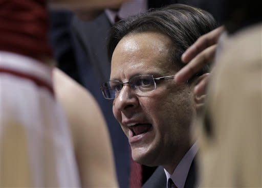 Indiana head coach Tom Crean talks to his team in a huddle during a timeout in the first half of an NCAA college basketball game against North Carolina Central in Bloomington, Ind., Wednesday, Feb. 22, 2012. (AP Photo/Michael Conroy)