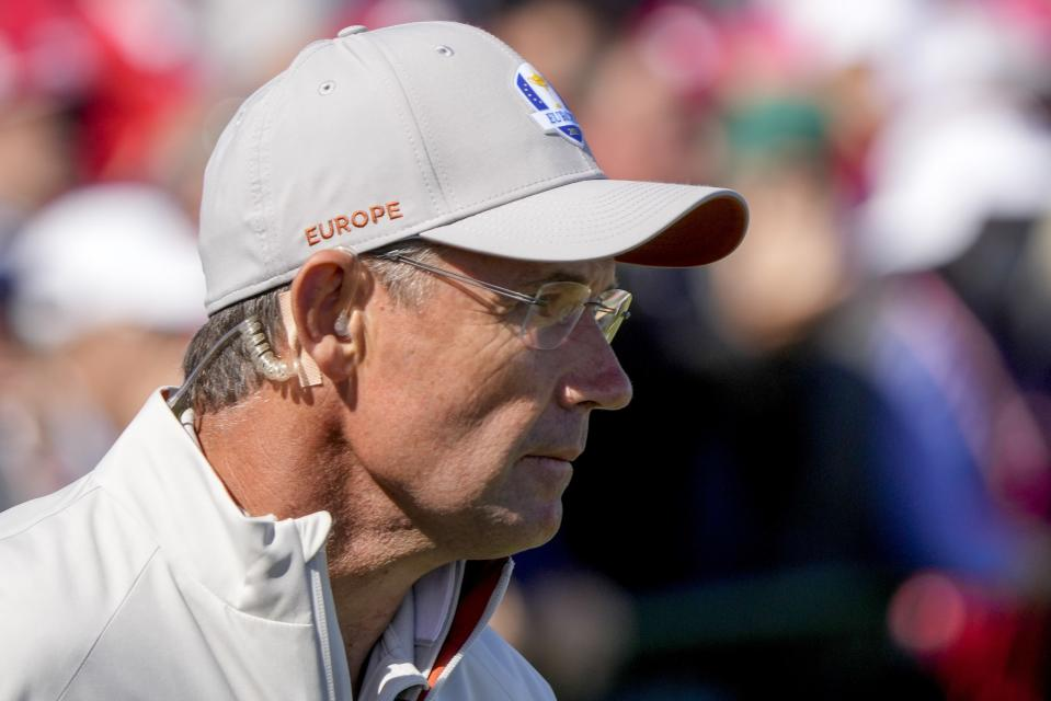 Team Europe captain Padraig Harrington watches on the 15th hole during a foursomes match the Ryder Cup at the Whistling Straits Golf Course Saturday, Sept. 25, 2021, in Sheboygan, Wis. (AP Photo/Charlie Neibergall)